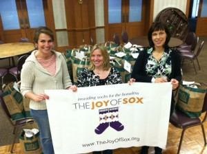 Sock sorting event at Shir Ami Congregation netted 853 pairs of socks for the homeless and The Joy of Sox. From L to R Rachel, Gail and Holly.