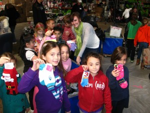 Children with new socks collected for the homeless for The Joy of Sox, a nonprofit that provides joy to the homeless with new socks.