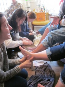 Villanova Nursing Without Borders tending to the feet of the homeless (The Joy of Sox - new socks for the homeless)
