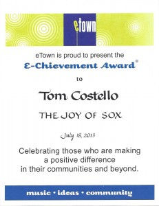 Tom Costello Jr, Chief Sock Person, The Joy Of Sox, received the prestigious e-Chievement award for providing new socks for the homeless from Helen and Nick Forster of eTown