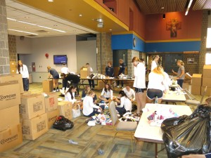 Some students from Villanova University sorting and packing new sock for the homeless for The Joy of Sox.