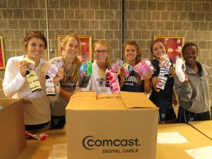 Socks donated by Comcast Cares being sorted by students from Villanova University