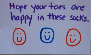 "A little card made by one of the volunteers for The Joy Of Sox.  This ""Hope your toes are happy in these socks"" note card was placed in a package of new socks that The Joy of Sox distributed to the homeless."