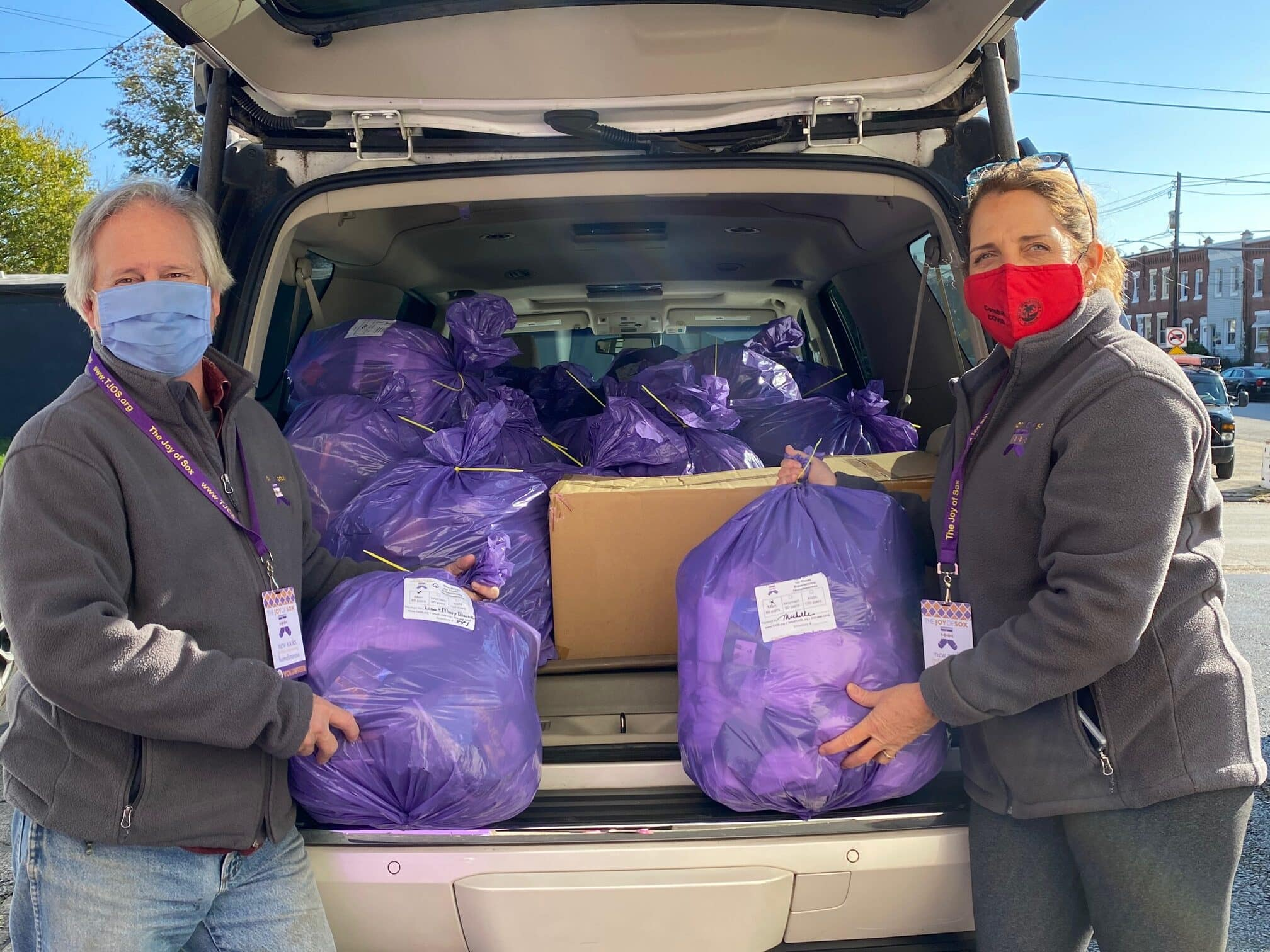 Greg (L) and Tracy loading bags of socks to be distributed to shelters.